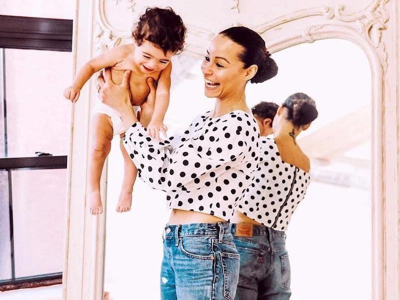 happy mom holding her baby